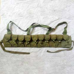 Cartoon Image of a Vietman Solider Wearing a Green Canvas 10 Cell AK Rifle Ammo Chest Rig